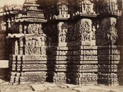 [Sculptural detail of projecting angles on the western side of the Hoysalesvara Temple, Halebid.]